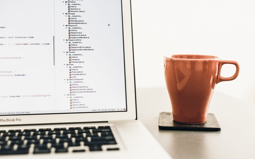 Reasons to Test Software represented by computer and coffee mug