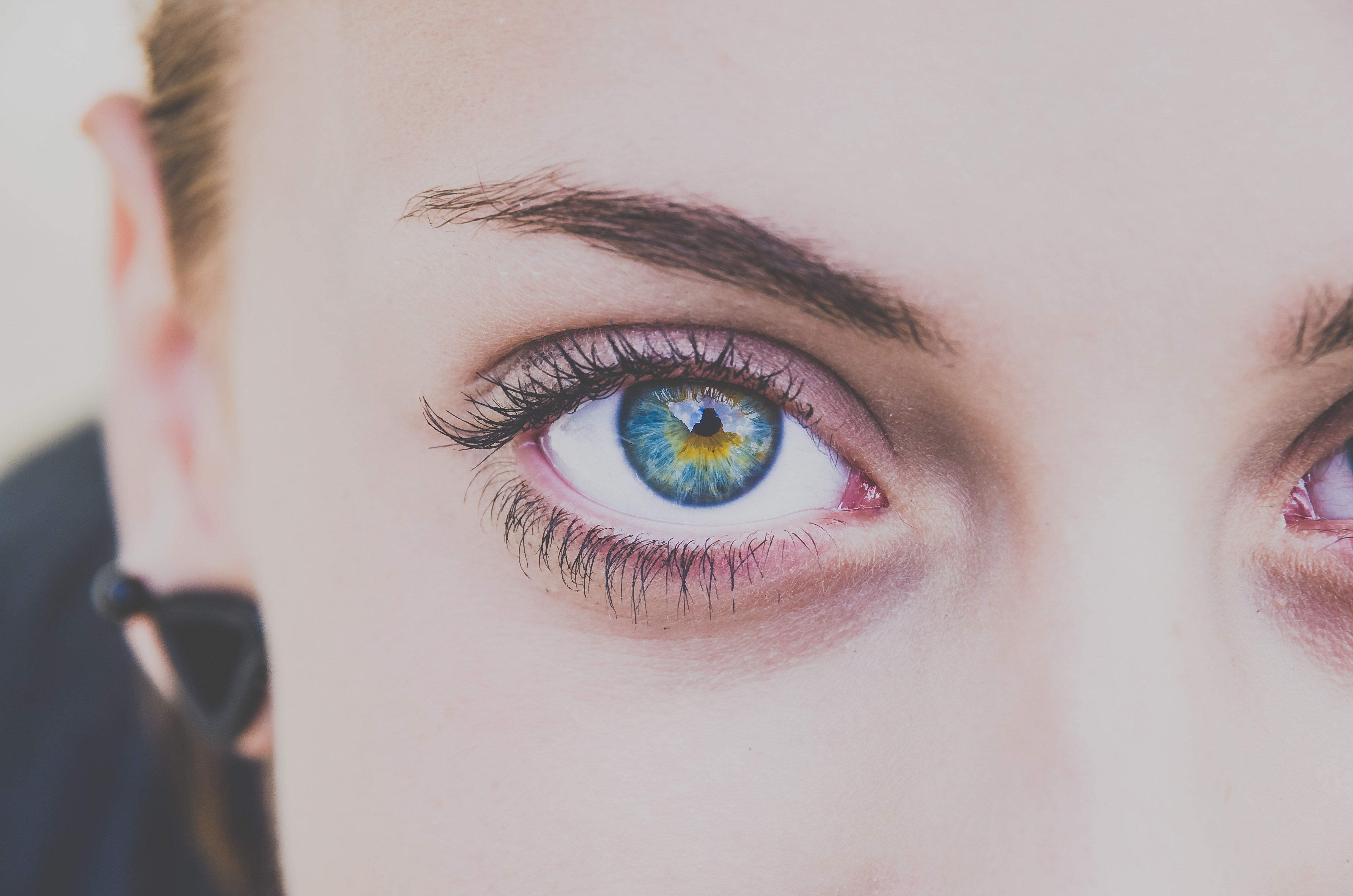 PAD testing represented by single female eye