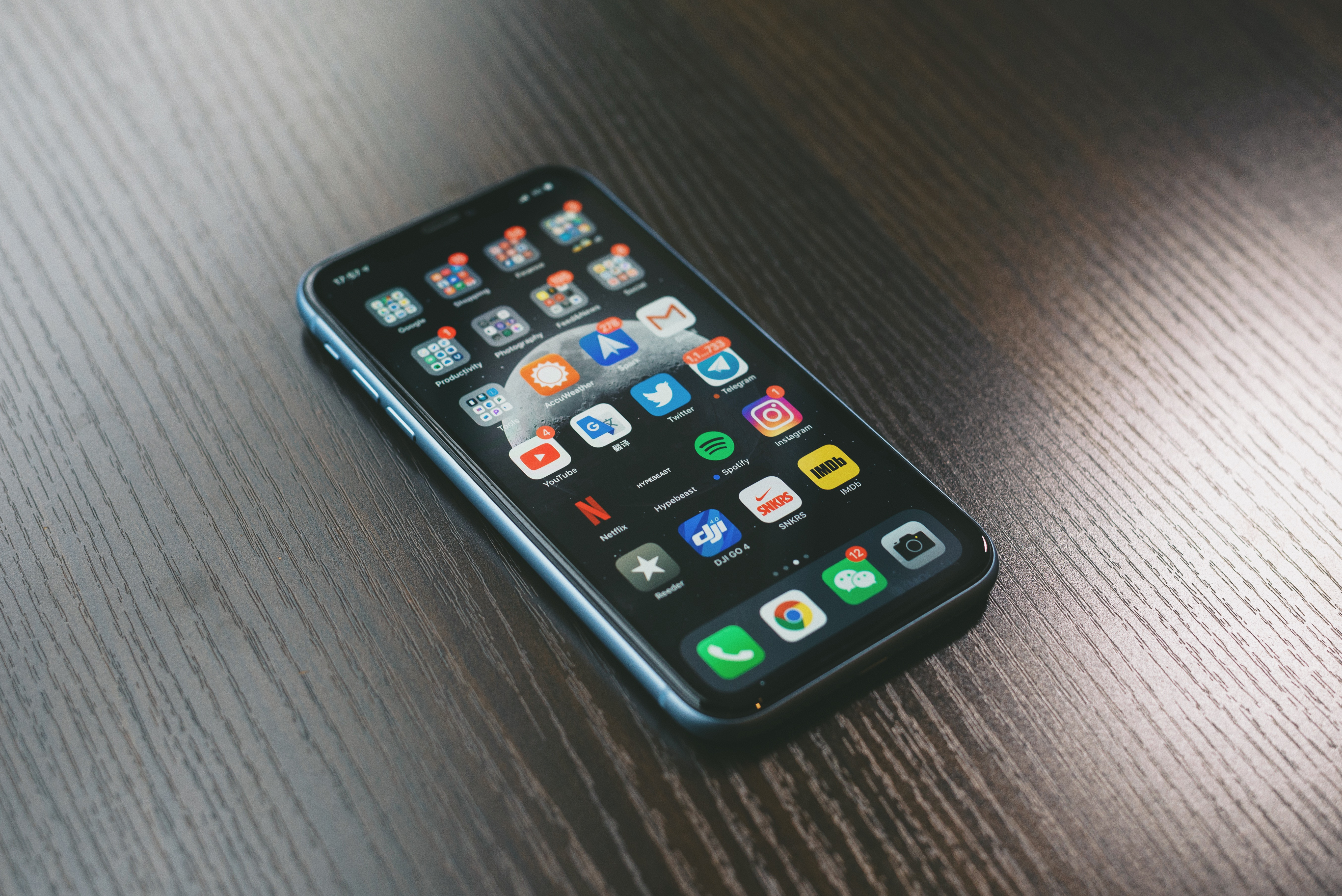 mobile app represented by mobile phone displaying app icons