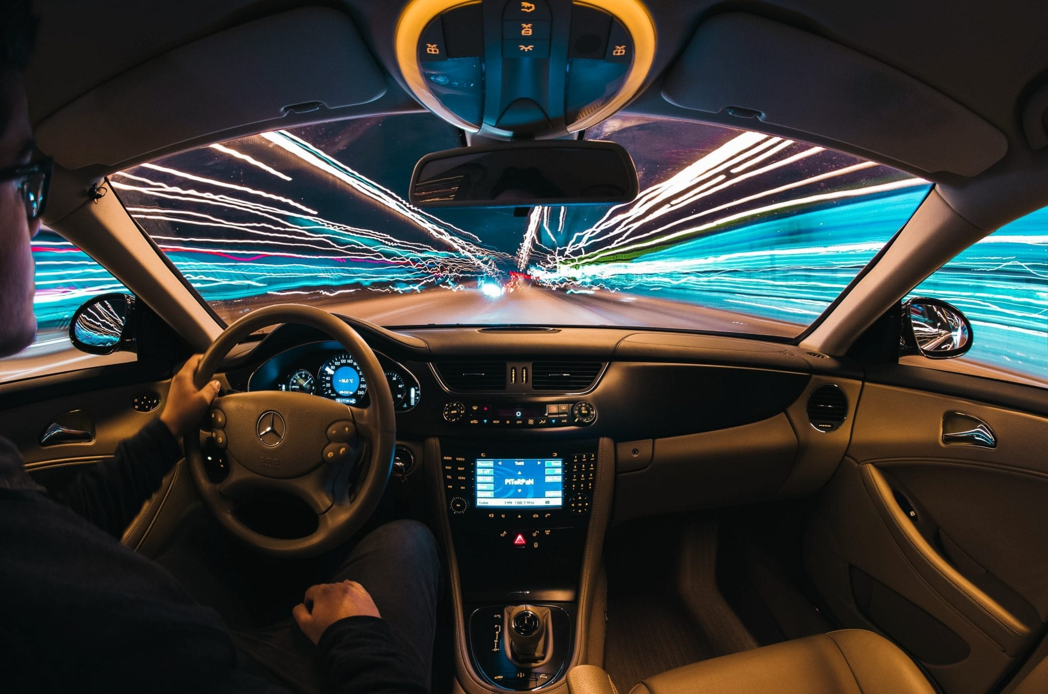 Cybersecurity and IoT Electronics represented by car dash and street lights
