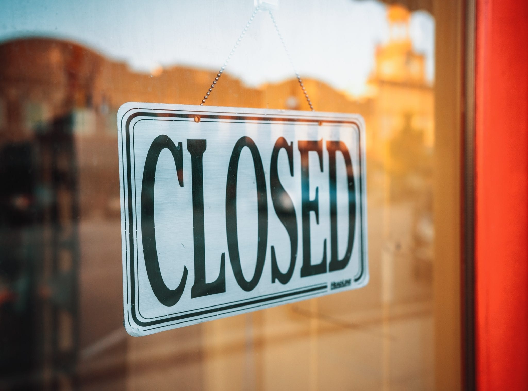 """e-commerce represented by """"closed"""" store sign"""